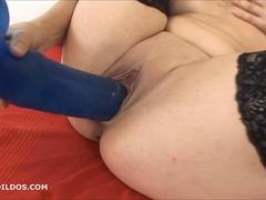 sticking a huge dildo deep in her soaking wet cunt