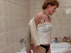 Granny with Glasses Shaves Her Pussy