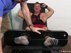 Hot muscle guy gets armpits and feet tickled hard by man