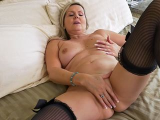 mature blonde bombshell teases in front of nude webcam and starts to play with her favorite dildo