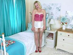 Blonde Anna Belle strips down to vintage bra garter belt with sheer nylons and plays with pussy