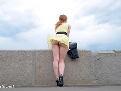 Wind blows up Jeny skirt to show she has no panties