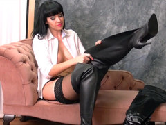 Kinky brunette with big tits puts on sexy leather boots with her nylon panties stockings suspenders