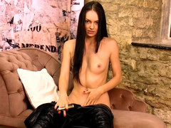 Stunning brunette Cath strips off leather catsuit spreads tight pussy masturbates with gold toy