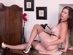 Busty brunette Tindra Frost masturbates in vintage black seam nylons and fuck me stiletto heels