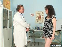 Doctor taking care of her mature vagina