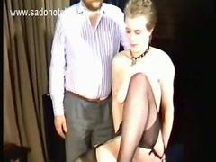 Milf slave got her legs spread by horny master and gets her pussy lips pierced with a large needle