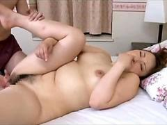 Hot Japanese MILF with big boobs gets licked and fingered