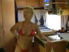 Mature blonde in red bikini