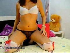 Small titted girl in stockings fucks herself with a dildo