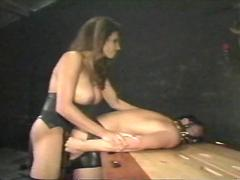 Shay Sights in latex fucks a guy with a strapon