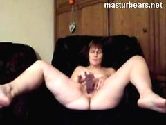 Very old short-haired woman toys her cunt