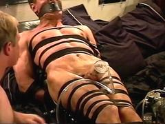 Extreme vacuum pumping CBT on leather bound and restrained muscle guy.