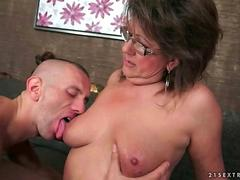 Mature woman enjoys a young cock in her pussy