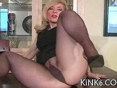 Nina Hartley poses in see through pantyhose
