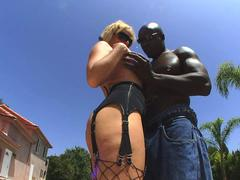 Mighty black stud lets a feisty white bitch play with his enormous boner