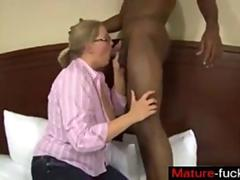 Nerdy blonde chubber dining on a big black dick