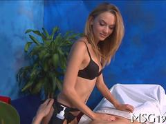 Sexy little hottie gives her first handjob in a massage parlor