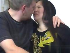 Big tits brunette impales her plump Asian pussy on white cock