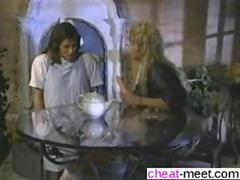 Blonde MILF gets her pussy toyed and licked under the table