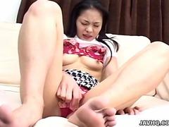 Asian kinky bitch is pinching on her nipples as she cums