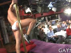 Masked stripper slings his dick to hot guys in a club