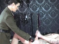 Nasty brunette in arm uniform helps her slave milk his cock