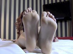 Mindblowing brunette proudly exposes her sexy feet