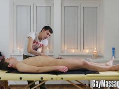 Ryan lies down on the massage table for a full body rubdown