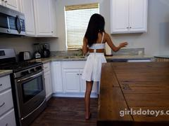Sexy petite asian teen fucks herself on kitchen table