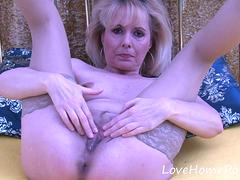 Mature blonde in stockings enjoys her masturbation session