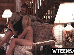 A kinky blonde cutie gets abused by a burglar on the couch