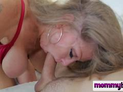 Stunning mature mommy wants to satisfy her step son and gives him a head at first and then spreads her legs