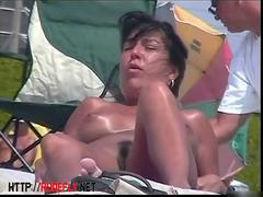 Beach voyeur porn featuring two hot girls and a guy sunbathing naked