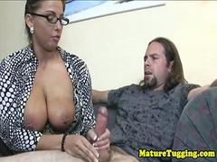 Curvy spex cougar gives sloppy handjob
