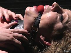 Big tits slave in doggy device bondage