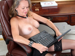 Granny in sexy lingerie is fingering her wet cunt in closeup for a webcam