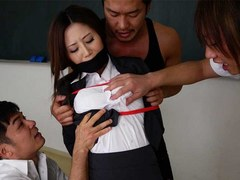 Three horny students have their way with stunning Japanese teacher