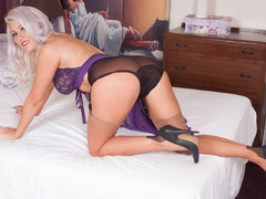 Blonde Lu Elissa fingering pussy on bed in black panties nylons and stiletto heels